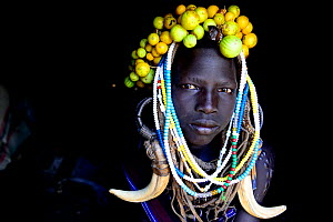 Young girl wearing traditional headdress. Mursi tribe, Mago National Park. Omo Valley, Ethiopia.  -  Enrique Lopez-Tapia