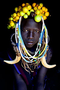 Young girl wearing traditional headdress, Mursi tribe, Mago National Park. Omo Valley, Ethiopia.  -  Enrique Lopez-Tapia