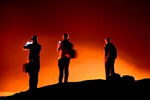 Travelers watching lava on Erta Ale volcano crater. Afar Region, Ethiopia, Africa. November 2014. - Enrique Lopez-Tapia