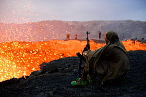 An armed soldier watching activity of Erta Ale volcano crater at dawn. Afar Region, Ethiopia, Africa. November 2014. November 2014.  -  Enrique Lopez-Tapia