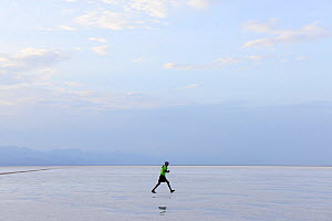 Person walking across Lake Assale, one of the largest salt lakes in Africa. Danakil Depression, Afar Region, Ethiopia, Africa. November 2014.  -  Enrique Lopez-Tapia