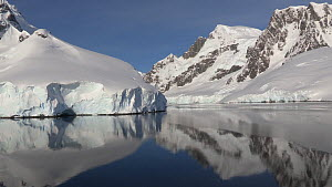 View of snow covered mountains seen from a boat passing through Lemaire Channel, Antarctic Peninsula.  -  Fred  Olivier