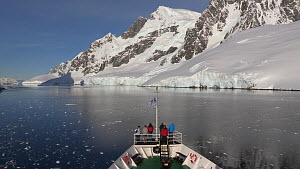Tilt shot up from a ship passing through Lemaire Channel, Antarctic Peninsula.  -  Fred  Olivier