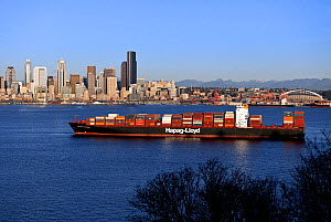 Freighter ship anchored, Elliot Bay, with the city of Seattle in the background. Washington, USA, February 2015.  -  Kirkendall-Spring