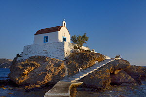 Agios Isidoros chapel, built on an islet in Gourna Bay, accessed by a wave-washed walkway, Kokkali, Leros, Dodecanese Islands, Greece, August 2013.  -  Nick Upton