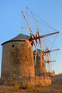 Restored windmills of the Monastery of St. John the Theologian at sunset, Chora, Patmos, Dodecanese Islands, Greece, August 2013.  -  Nick Upton