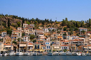 Sailing yacths moored on the quay at Poros town harbour viewed from the sea, Poros island, Attica, Peloponnese, Greece, August 2013.  -  Nick Upton