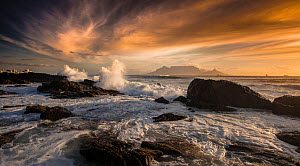 Table Mountain viewed from across the sea at sunset, Cape Town, South Africa  -  Wim van den Heever