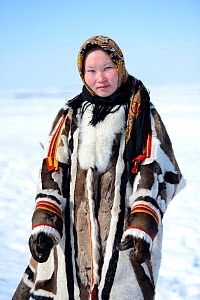 Carolina Serotetto, Nenet teenager in traditional winter coat made with reindeer skin. The collar is arctic fox fur and black beaver with felt ribbons. Yar-Sale district, Yamal, Northwest Siberia, Rus...  -  Eric Baccega