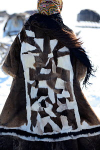 Nenet teenager dressed in traditional winter coat made with reindeer skin.  Yar-Sale district, Yamal, Northwest Siberia, Russia. April 2016.  -  Eric Baccega