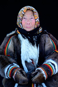 Tatiana Salinder, portrait of Nenet herder in winter coat of reindeer fur. The collar is arctic fox fur with black beaver fur and felt ribbons. Yar-Sale district, Yamal, Northwest Siberia, Russia. Apr... - Eric Baccega