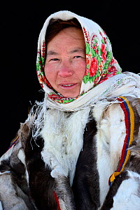 Natacha Serotetto, portrait of Nenet herder in winter coat made from reindeer fur. The collar is made of arctic fox fur, black beaver fur strap decoration and felt ribbons. Yar-Sale district, Yamal, N... - Eric Baccega