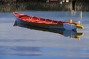 Small  whaling boat on calm water, Azores Islands, Portugal.  -  Doc White