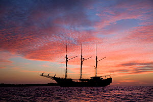 Luxury liveaboard Paradise Dancer at sunset, North Sulawesi, Indonesia, Pacific Ocean. May 2008. - Franco  Banfi