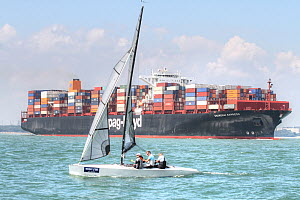 Sailing boat in front of container ship in The Solent, UK. August 2015. - Ingrid  Abery