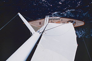 View down from the top of the mast of the sailing yacht Savannah, with crew hiking out. - Nic  Compton
