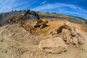 Commercial oolitic limestone extraction for construction and dry stone walling, Huntsmans Quarry, Naunton, Gloucestershire, UK. July 2015. - Nick Turner