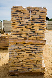 Dry stone walling material packed for shipping, Huntsmans Quarry, Naunton, Gloucestershire, UK. July.  -  Nick Turner