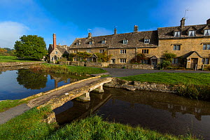 Cotswolds village of Lower Slaughter with stone clapper bridge, Gloucestershire, UK. October 2015.  -  Nick Turner