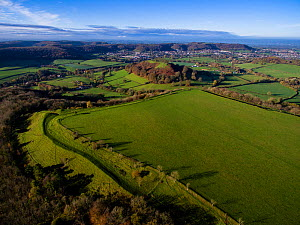 Uley Bury iron-age hill fort on Cotswold escarpment, defensive ditches still visible. Gloucestershire, UK.  Aerial drone with CAA permit. November 2015.  -  Nick Turner