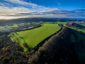 Uley Bury iron-age hill fort on Cotswold escarpment, Gloucestershire, UK. Aerial drone with CAA permit. November 2015.  -  Nick Turner