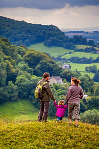 Family walking on Selsley Common on the Cotswold Way, Gloucestershire, UK. August 2012.  -  Nick Turner