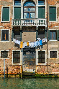 Washing drying outside Venetian waterside apartment, Venice, Italy, April. - Gary  K. Smith