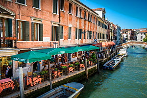 Riverside restaurants on Rio De San Lorenzo, Venice, Italy, April.  -  Gary  K. Smith