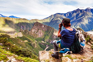 Woman admiring view from the Sun Gate, Inca Trail, Peru. December 2013.  -  Merryn  Thomas