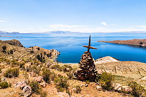 Cairn with cross on Isla del Sol, Lake Titicaca, Bolivia, December 2013.  -  Merryn  Thomas