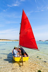 Man and woman sailing a mirror dingy, St.Martin's, Isles of Scilly, England. August 2013. Model released. - Merryn  Thomas
