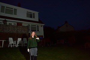 Samantha Pickering preparing to release a Common pipistelle bat (Pipistrellus pipistrellus) in her garden after it was rescued locally and fully reabilitatated at her bat sanctuary, North Devon Bat Ca... - Nick Upton