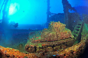 A diver above a tank laying on the deck of the wreck of the Nippo Maru, a cargo ship used as a naval auxiliary, Chuuk or Truk Lagoon, Carolines Islands, Pacific Ocean  -  Pascal Kobeh