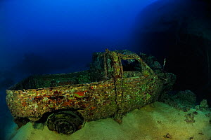 The wreck of a pick-up or a van in Shaab Suedi also called Toyota Reef, the reef where the Blue Bell / Belt sank in 1977 with its load of cars and vans, Red Sea, Sudan  -  Pascal Kobeh