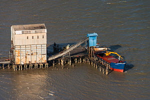 Aerial view of loading sugar on barge to export, coastal Guyana, South America  -  Pete Oxford