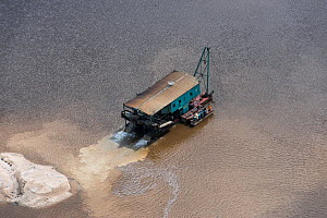 Aerial view of gold dredger in Essequibo river, Guyana South America - Pete Oxford