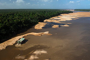 Gold dredger on Essequibo river, the longest river in Guyana, South America - Pete Oxford