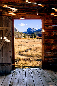 View through doorway of Osborn Cabin of Squaretop Mountain in Green River Valley, Bridger National Forest, Wyoming, USA. September 2015. - Kirkendall-Spring
