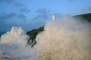 Trevose Head Lighthouse with waves crashing against cliffs, north Cornwall, England, UK, November.  -  Andrew Murray