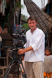 Wildlife cameraman and photographer Paul D. Stewart in Cambodia filming for the BBC Natural History Unit. March 2013.  -  Paul  D Stewart