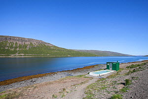 Small thermal hotpool and hut on the shore of the Westfjords, Iceland, June 2011.  -  Iris Thorsteinsdottir