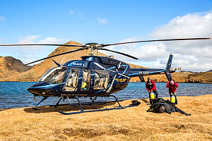 Heli-diving, downloading the scuba diving equipment from the helicopter on a mountain lake, Iceland  -  Franco  Banfi