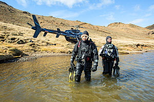 Heli-diving, going into the water for a scouting scuba dive in a mountain lake, Iceland  -  Franco  Banfi