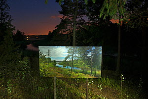 Photograph taken by day displayed in same landscape at night, 'The passage of time' by artist Pal Hermansen. Valer, Ostfold County, Norway. July 2014. - Pal Hermansen