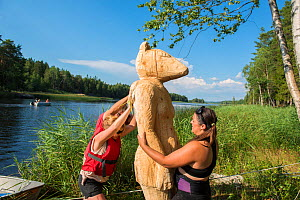 Artists erecting sculptural artwork 'The other side'. Ostfold County, Norway. July 2014.  Model released.  -  Pal Hermansen