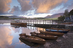 Boats moored by jetty on Derwent Water at dawn, Keswick, Lake District, Cumbria, England, UK. October 2012.  -  Adam Burton