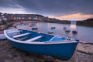 Rowing boat in Mousehole harbour at dawn, Cornwall, England, UK. April 2013.  -  Adam Burton
