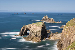 Enys Dodnan, the Armed Knight with Longships Lighthouse in distance, Land's End, Cornwall, England, UK. April 2013. - Adam Burton