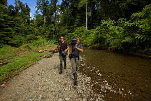 Eric Liner and Ian Fein, filming along a river in the Oransbari area, Irian Jaya, West Papua. August 2009. - Tim  Laman