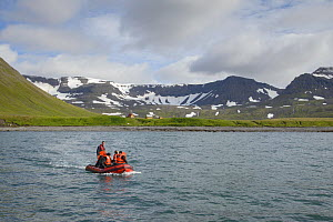 Inflatable boat picking residents up from Summer houses, Hornstrandir, Iceland. July - Terry  Whittaker
